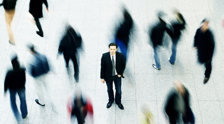 Business man surrounded by people