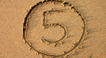 The number 5 written on the beach.  Part of a countdown series.