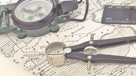 Old Maps with compass and magnifier